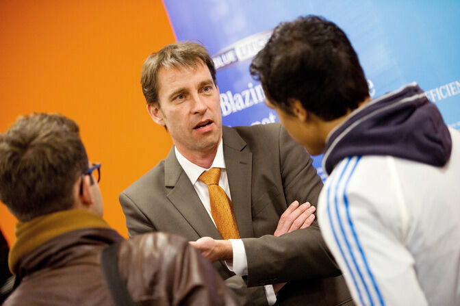 Businessman speaking with students